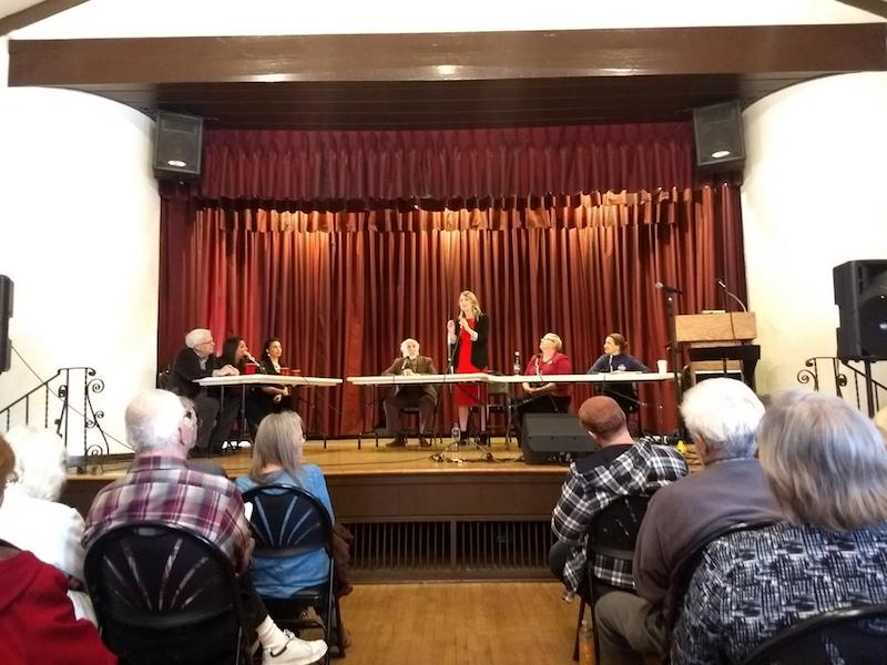 Candidates running for Congress made statements at the town hall meeting Saturday. Photo credit: Alex Grant