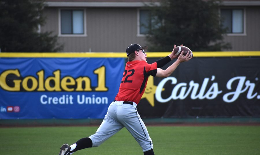 Blake+McFadden%2C+the+left+hander+pitcher+from+Northwest+Nazarene%2C+warms+up+before+the+3%3A30pm+game+on+February+9th+by+catching+football+passes+from+his+teammates.+Photo+credit%3A+Martin+Chang