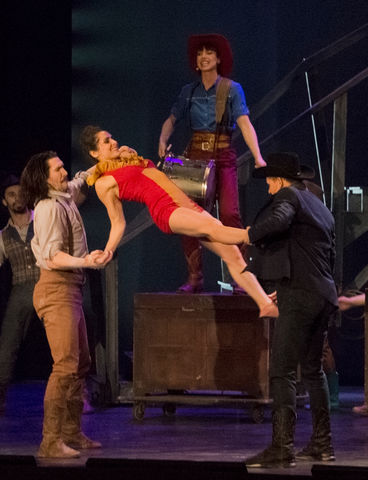 Acrobat Justine Methe Crozat is tossed around by Trevor Pool and Jules Trupin, as Sophie Beaudet sings on.