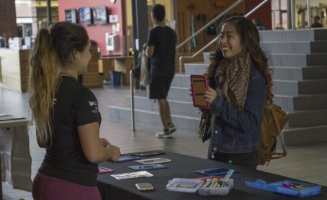 Chico State student Sydney Nguyen shows WREC staff member Mara Johnson her creation. Photo credit: Carly Maxstone