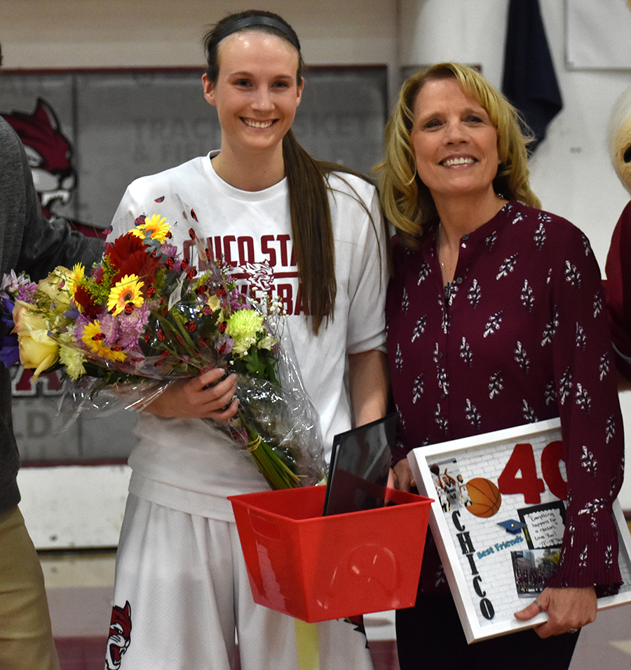 Senior Haley Cremen, left, poses with her mother, Penni Cremen. Cremen was one of four seniors  honored during Saturday's Senior Night. Photo credit: Martin Chang