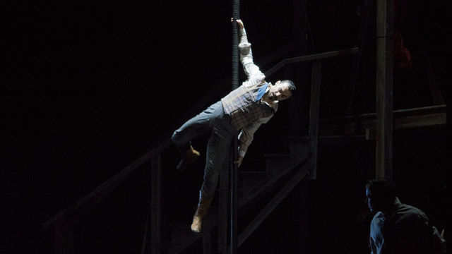 Acrobat+Felix+Pouliot+gracefully+swings+around+a+pole.