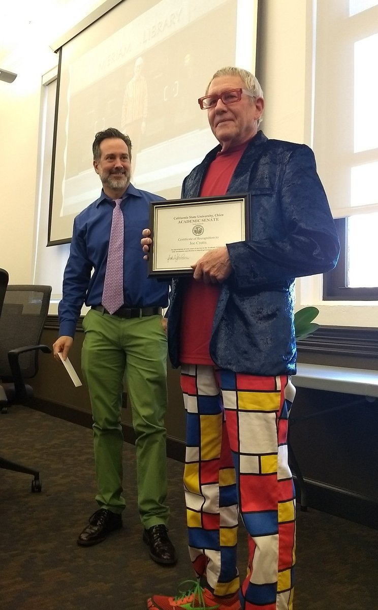 Jed Wyrick (left) gives Joe Crotts(right) a certificate of recognition. Crotts retired yesterday after serving on the senate since 1981.
