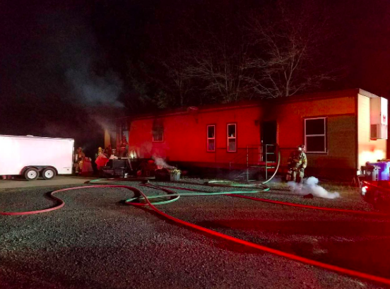 Paradise man escapes mobile home fire