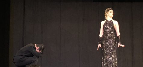 Tamino (Mickensie Layson) kneels in fear of the Queen of the Night (Kaila Davidson). Photo credit: Natalie Hanson