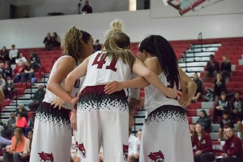 Whitney Branham, McKena Barker, Jo Paine and Shay Stark huddle up in a matchup against UC San Diego Photo credit: Kate Angeles