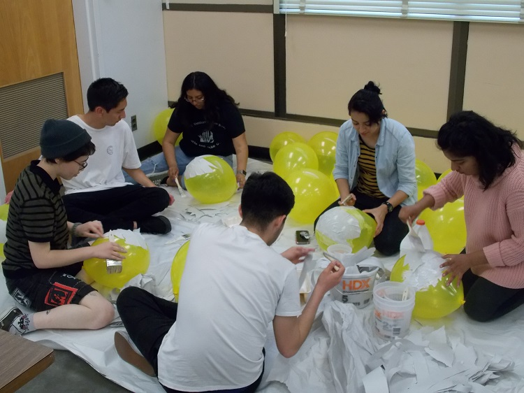 Students+creating+%22debt+boulders.%22