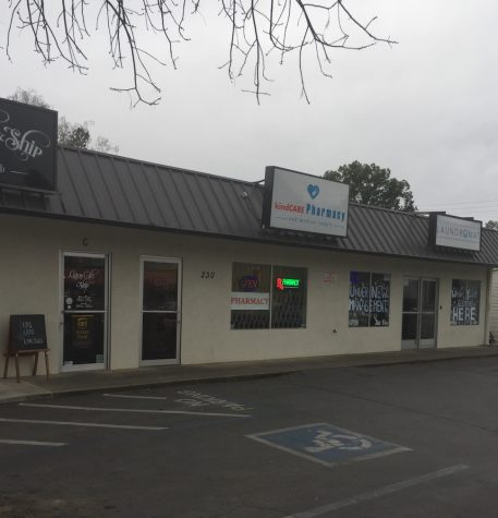 Armed suspect at large after assaulting local business owner