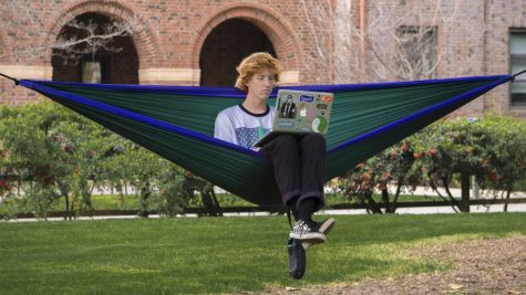 Cody Roberts hammocks on the Kendall lawn to take a breather from the dorms this Monday. Photo credit: Carly Maxstone