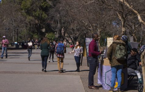 Chico State students walking through campus while getting informed of local or campus activities on March 6. Photo credit: Maria Ramirez