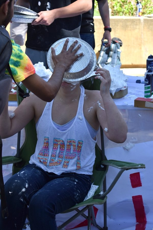Madison+Ramirez+received+a+face+full+of+shaving+cream+Wednesday+at+Alpha+Delta+Pi+and+Sigma+Pi%E2%80%99s+Pie+a+Pi+event.+All+of+the+proceeds+went+toward+the+Ronald+McDonald+House+Charities+and+The+Amazing+Day+Foundation.