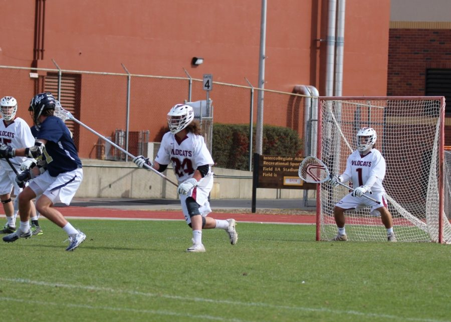 Chico State goalie Gavin Risbry making sure no goals get passed him while Quinn Gaebler defends. Photo Courtesy of Shelly Risbry
