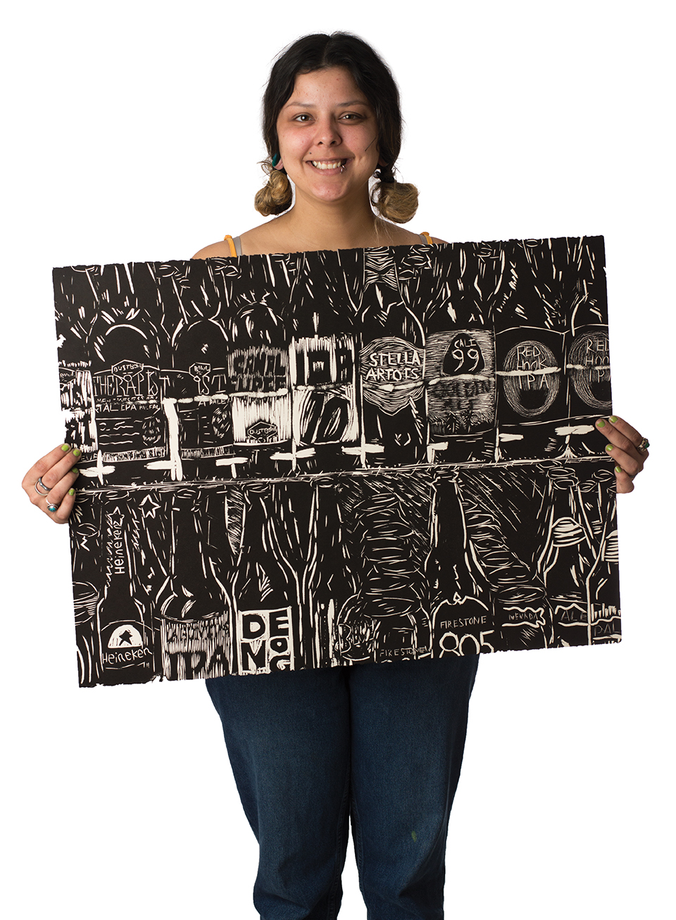 Marisa Sergovia holds up one of her paintings. Photo credit: Sean Martens