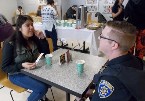 Unique Danovaro got the chance to ask Sergeant Jason Plainer questions at Coffee with Cops. Photo credit: Josh Cozine
