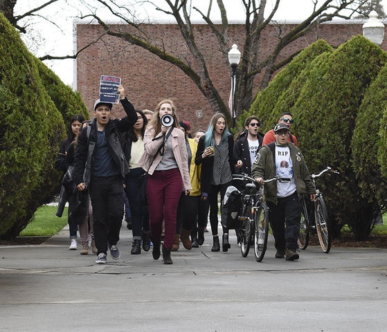 Chico State students march toward Kendall Hall to protest gun violence