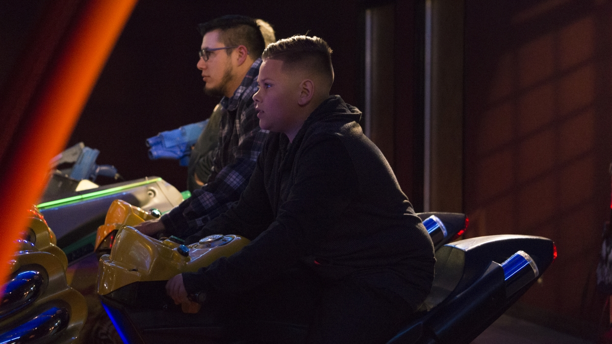 Christian Pata-Koehler and Dustin Boster play a motorcycle racing game in an arcade at the Cinemark movie theater. Photo credit: Carly Maxstone