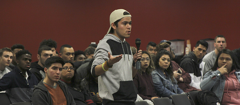 Aldon Perez, a freshman distance track and field athlete, speaks in favor of the student fee increases at an open forum on March 6.