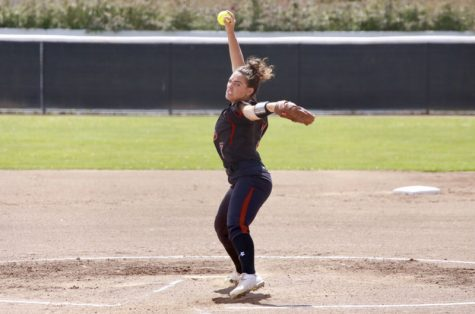 Pitcher Haley Gilham winding up for a pitch against San Francisco State. Photo Courtesy of Janna Weiss Photography