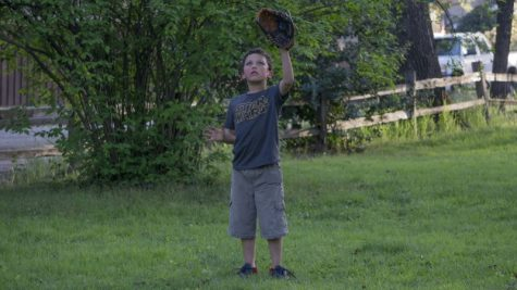 Vidal Hernandez Jr. plays catch with his father on Bidwell Park this Sunday. Photo credit: Carly Maxstone
