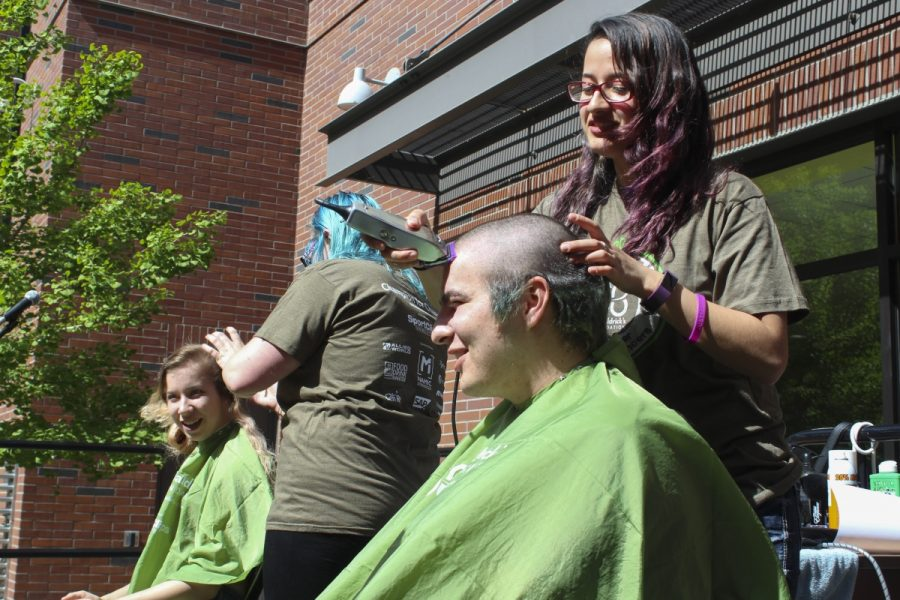 Students+Mikaela+de+France+and+Lance+Robert+Carlisle+step+up+to+get+their+heads+shaved+in+at+the+St.+Baldricks+Foundation+Fundraiser+in+the+Sutter+Courtyard+on+Friday+morning.+Photo+credit%3A+Anne+Chamberlain