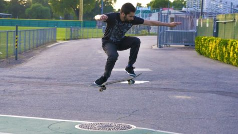 Chris Dubois unwinds on his skateboard after class this Tuesday. Photo credit: Carly Maxstone