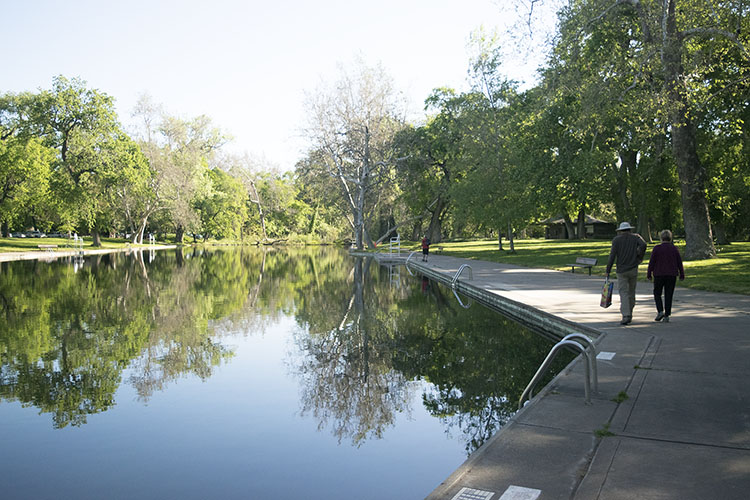 A couple walk along the swimming area at Bidwell Park One Mile, April 20. Photo credit: Rachael Bayuk