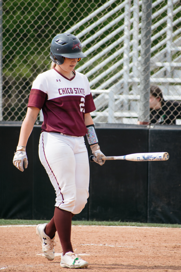 Chico State's softball catcher makes her way up to the plate to bat. Photo credit: Kate Angeles