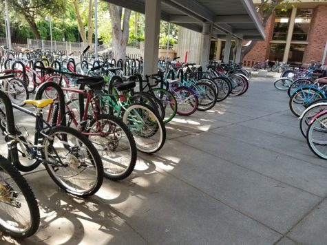 Whitney Hall is a common place for students to lock their bikes because of the number of students living in the dorms on campus.