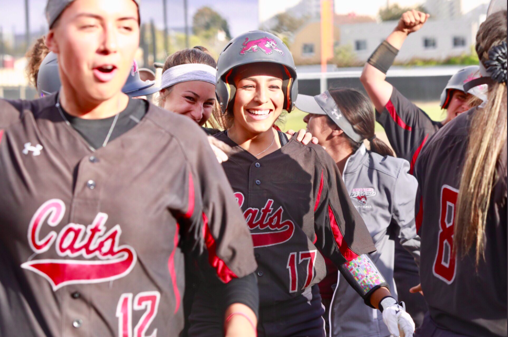 Amanda Flores celebrating with teammates moments after hitting the game tying grand slam against San Francisco State. Photo Courtesy of Jana Weiss