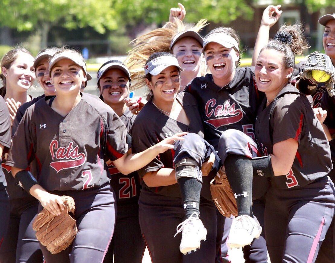 Chico State shortstop Wendy Cardinali is carried off the field by teammates Haley Gilham and Amanda Flores. Cardinali made a diving catch at shortstop with the tieing run at third base and the go-ahead run at second to end the game. Photo Courtesy: Janna Weiss Photography