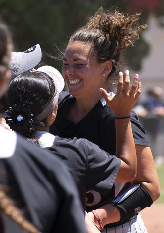 Softball coach earns 200th victory at tournament
