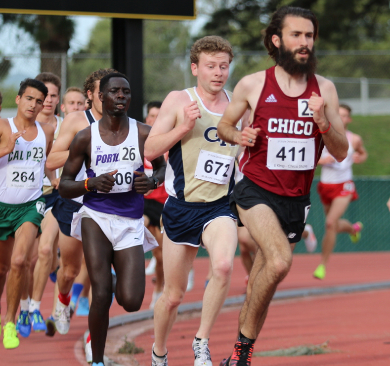Eddie King races in the 5,000 meter run. King finished first in the CCAA championship on Saturday. Photo Courtesy: Gary Towne. Photo credit: Gary Towne