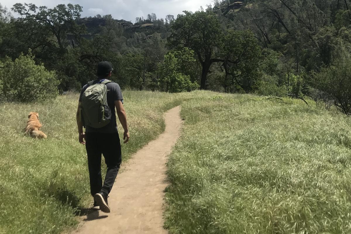 Victor Guerrero along with his dog hiking the Yahi Trail. Photo credit: Katalina Santamaria