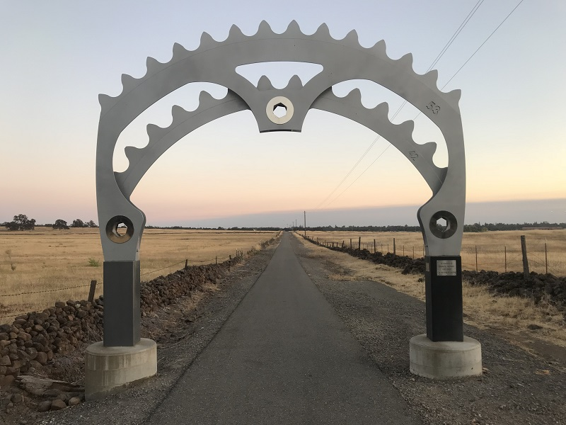 The Steven G. Harrison Memorial Arch stretches over the entrance to the bike path bordering the east side of the preserve. The arch was donated to the city of Chico by Linda L. Zorn in 2010. Photo credit: Dan Christian