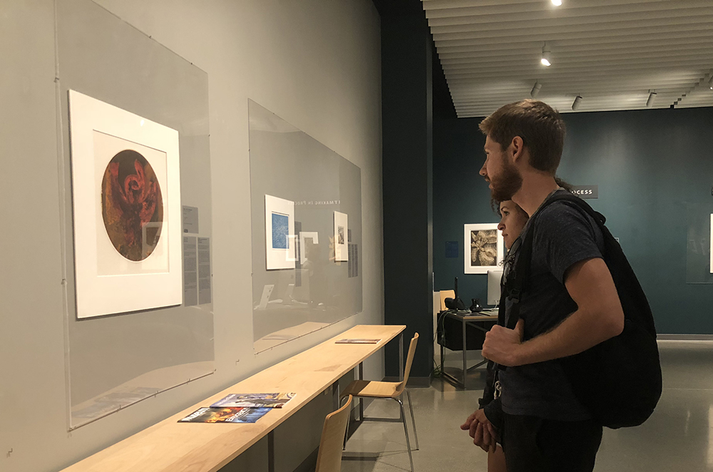 Simon Halland and Sophia Zoller admire some of the work showcased at