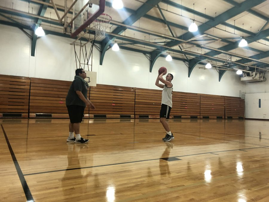 Nate Ambrosini working on his jump shot before Chico State basketball practice. Photo credit: Wesley Harris