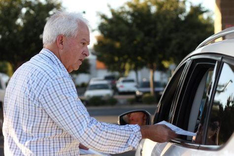 John Cox greets people gassing up at the Chico Costco, Friday, talking about Prop. 6, the gas tax repeal. Photo credit: Caitlyn Young