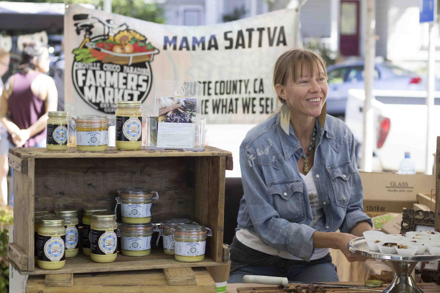 Indya Gage talks with customers about her product at the Chico Saturday Farmers Market. Photo credit: Brian Luong
