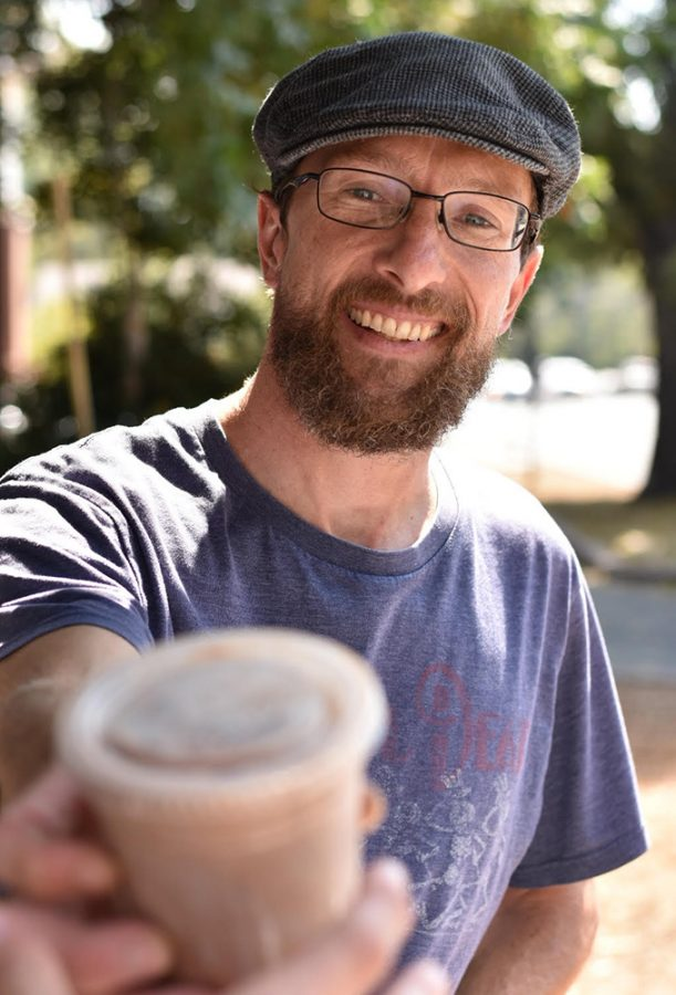 Shift+Bicycle+Cafe+Owner+and+Operator+John+Hanna-Barton+hands+a+student+his+freshly+made+iced+mocha.+Hanna-Barton+can+make+anything+from+pour-over+coffee+to+an+iced+mocha+with+almond+milk.