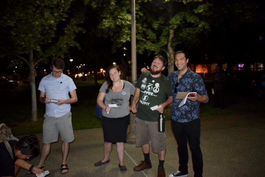 Evan Annenson, Daniel, Brooke Houston, Steve Breedlove and Nick are pictured here after banning together at the Chico City Chambers to voice their disapproval of the sit and lie ordinance. They sing after a controversial night. Photo credit: Daelin Wofford