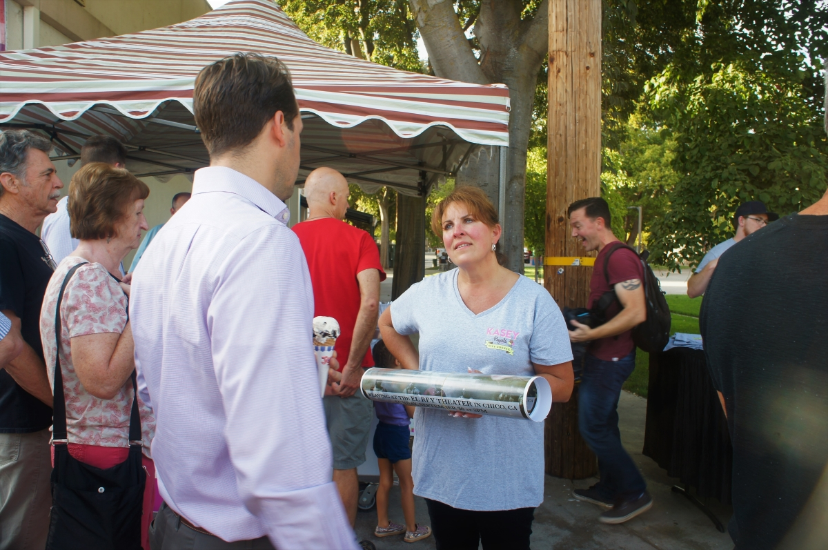 Kasey Reynolds talking to members of the community at the #StompOutHate ice cream social. Photo credit: Keelie Lewis