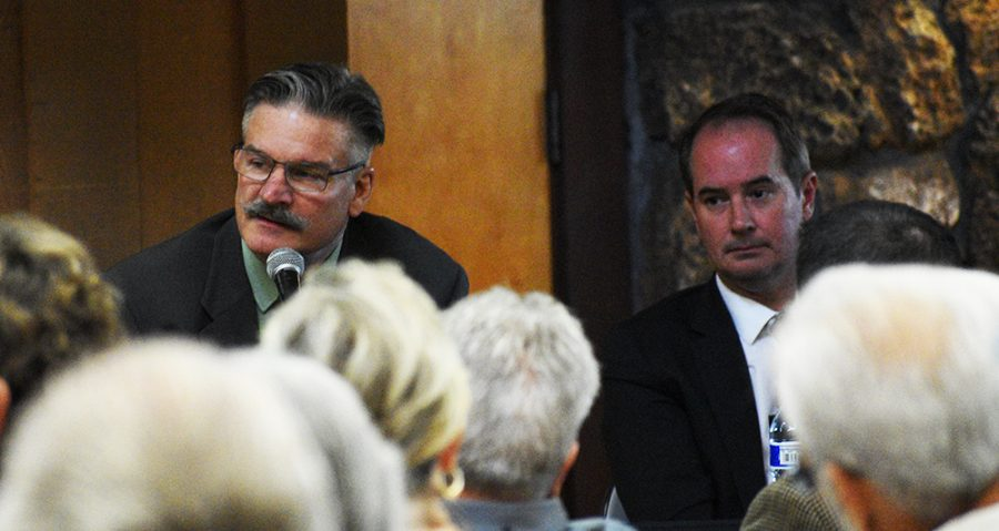 Andrew Coolidge (right) listens to fellow city council candidate Scott Huber (left) as Huber gives his final statement.