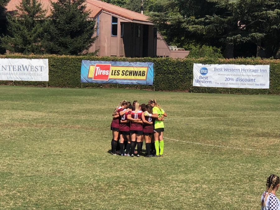 Wildcat starters huddle before the start of the second half against Colorado School of Mines on Sunday afternoon Photo credit: Wesley Harris