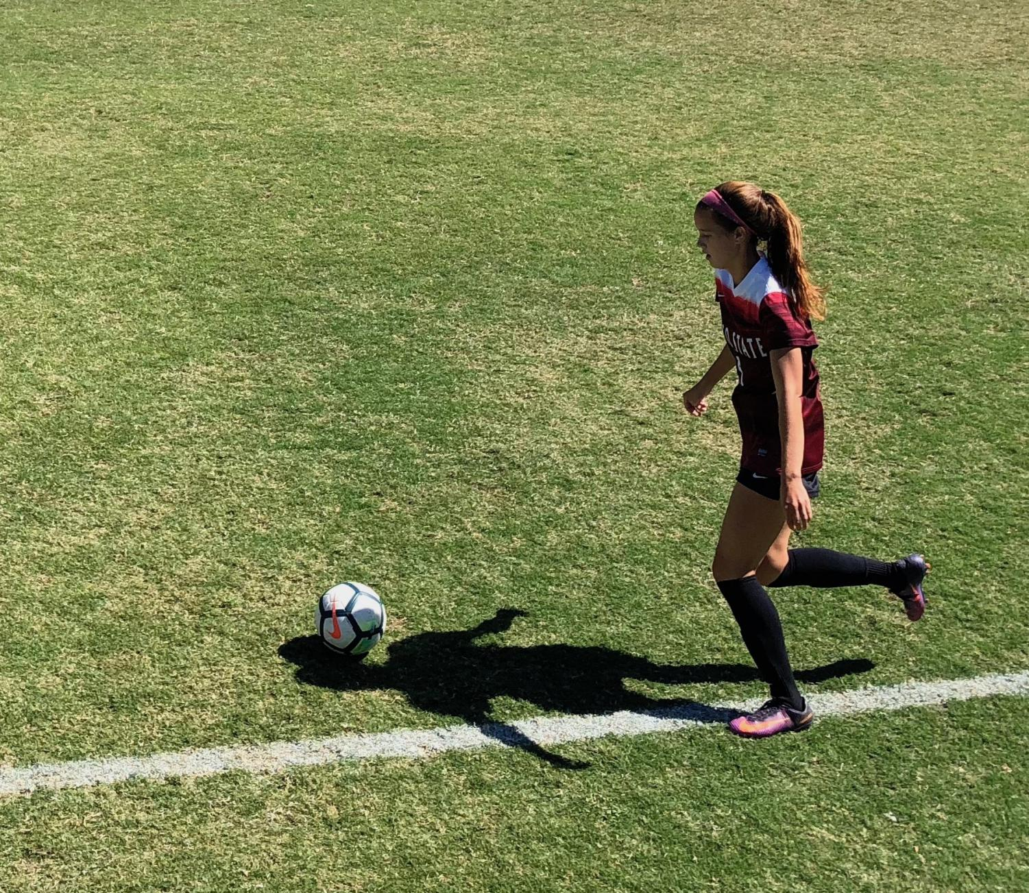Chico State's #9 Korie Bozart makes a cross against Dominguez Hills on Sunday. Photo credit: Wesley Harris