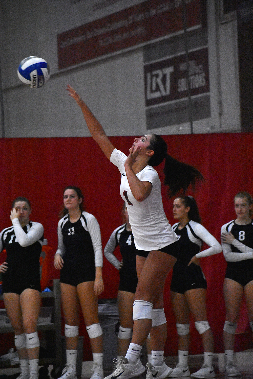 Libero Brooke Fogel back-row attacks the ball against Cal State San Bernardino earlier in the year in this archived photo. Photo credit: Julia Maldonado