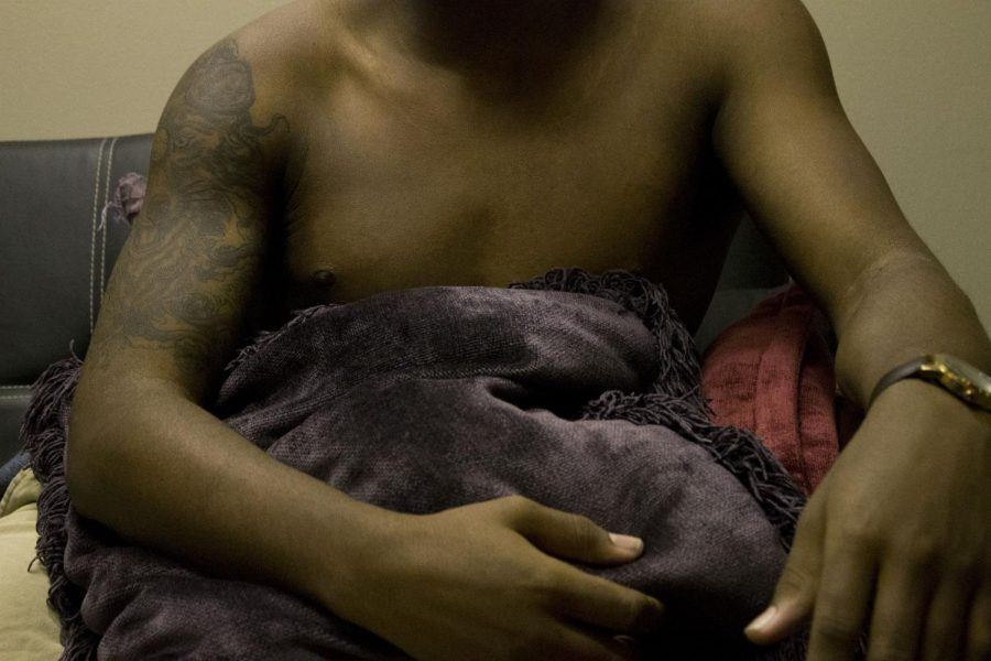 This man covers himself with a pillow. He is not a sex worker, but men often cover there genitals up before showing something to viewers. Photo credit: Dominique Wood