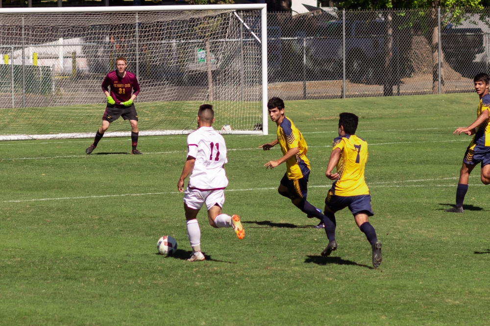 Chico State Midfielder, Cooper Renteria, looks to shoot the ball against UC Santa Cruz in this archived photo. Photo credit: Maury Montalvo