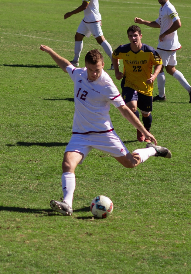 Joshua Belda delivers a pass down the field Sunday against UC Santa Cruz. Photo credit: Maury Montalvo