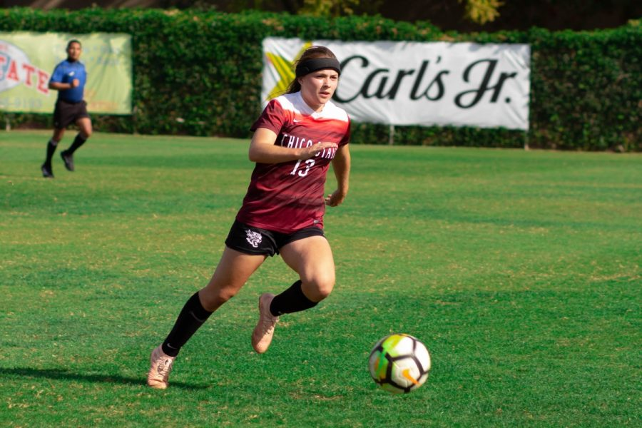 Chico State midfielder Sarah Emigh moves the ball upfield against UC San Diego on Saturday. Photo credit: Maury Montalvo