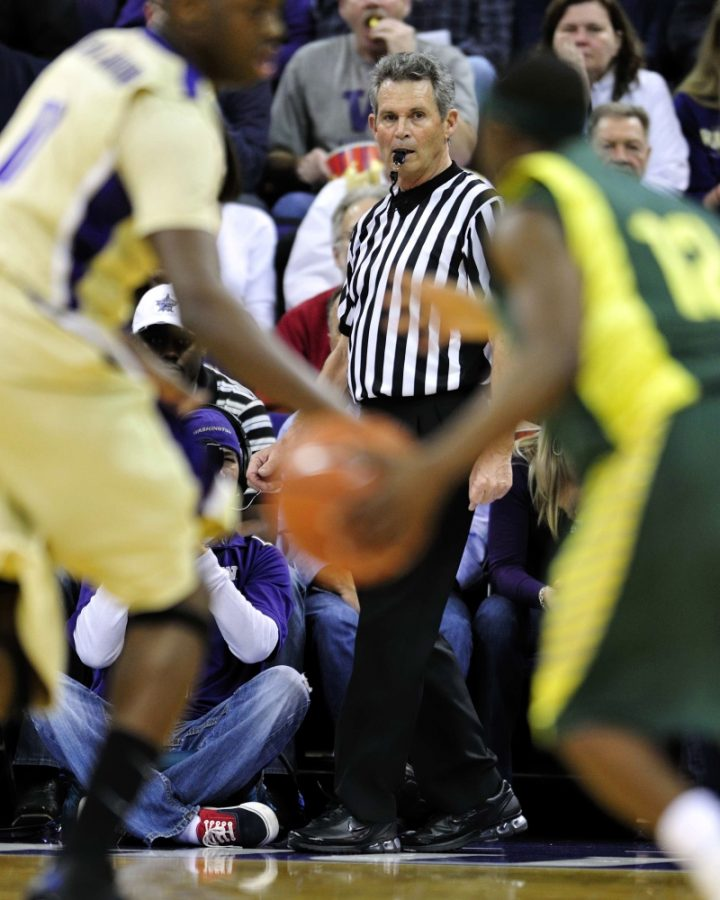 Reischling officiating University of Oregon basketball match. Photo courtesy of Mark Reischling.